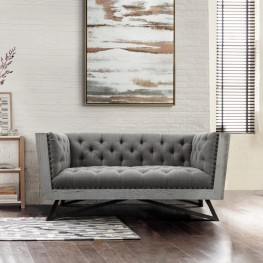 Regis Contemporary Loveseat in Grey Fabric with Black Metal Finish Legs and Antique Brown Nailhead Accents