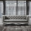Regis Contemporary Sofa in Grey Fabric with Black Metal Finish Legs and Antique Brown Nailhead Accents